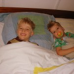 Two kids sharing a bed in Paris