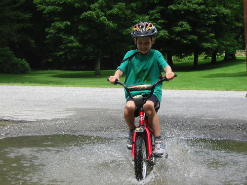 Riding through puddles on the Stowe Vermont rec path