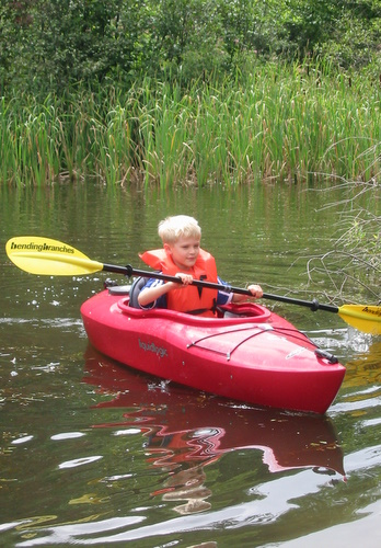 Tommy kayaking in the pond