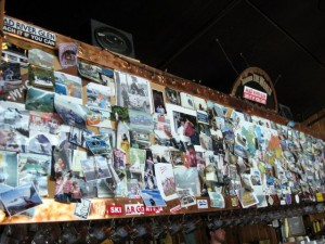 Wall of photos over the bar at Mad River Glen
