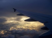 Sky, clouds, and airplane wing