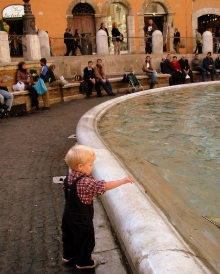 Tommy throwing a coin in the Trevi Fountain