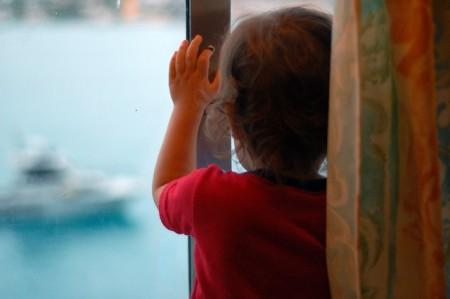 Child looking at ship