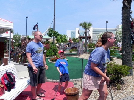 Playing pirate minigolf Virginia Beach