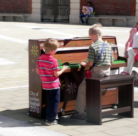Tommy playing the piano in London