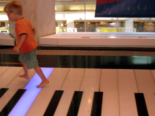Teddy playing on the Big Piano at FAO Schwarz