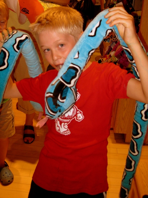Tommy and stuffed snake at FAO Schwarz