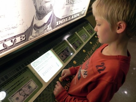 Looking at money at the Delaware Children's Museum
