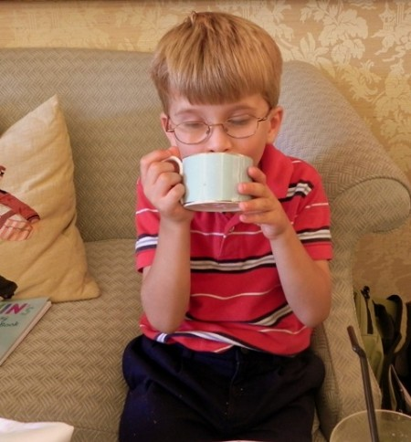 Teddy sipping tea in London