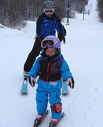 Harley Johnson skiing with her daughter