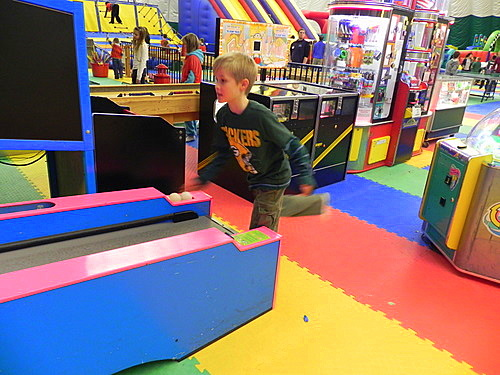 Tommy playing skee ball, Smuggs Funzone