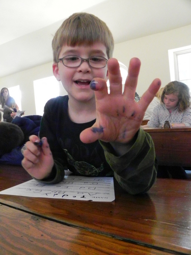Writing with a quill pen at the Hagley Sunday School