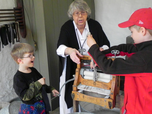 Using a mangle at the Gibbons House, Hagley Museuem