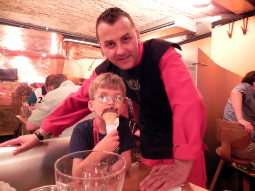 Eating in London: Waiter in a monk's habit at Belgo Centraal