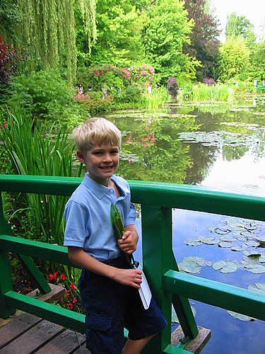 Tommy on a bridge in Monet's garden