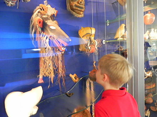 Looking at objects in the Windows On exhibit, NMAI