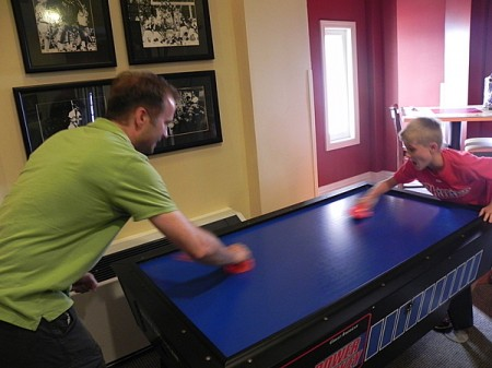 Playing air hockey at the Marriott Custom House, Boston