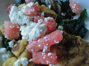 Crispy chicken with feta, watermelon, cornmeal gnocchi, and chard at Hourglass Restaurant