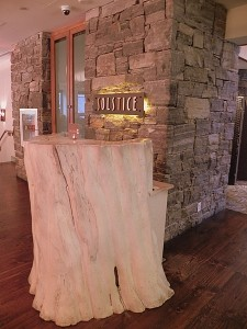 The host station at Solstice Restaurant is a maple tree that was removed when the hotel was built