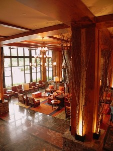 Trees are used as a decorative element in the lobby at Stowe Mountain Lodge