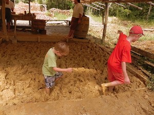 Walking in the mud at the Colonial Williamsburg brickyard