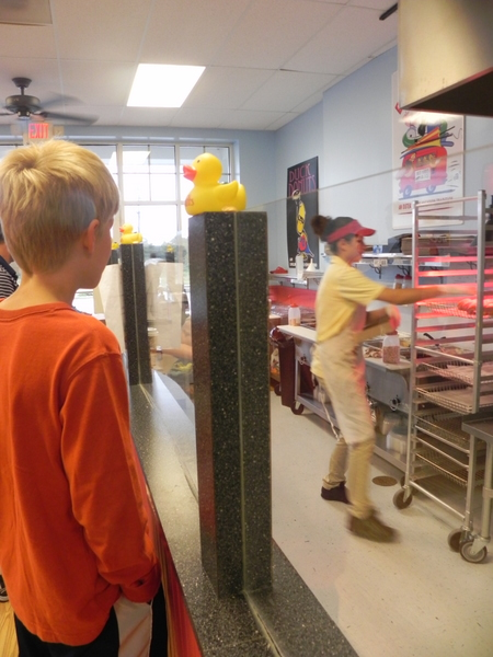 Glazing the donuts at Duck Donuts in the Currituck Outer Banks