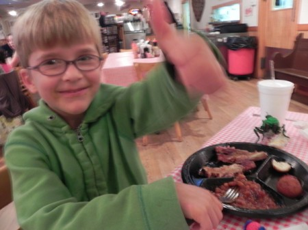 Thumbs up for ribs at High Cotton BBQ in Kitty Hawk