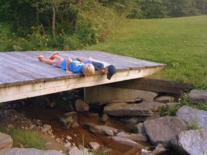 Lying on the Skinner Barn Bridge in Waitsfield, Vermont