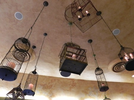 The Trellis Restaurant in Williamsburg is decorated with birdcages