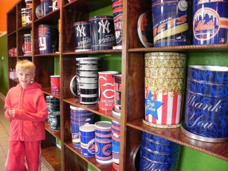 Fill a tin with flavored popcorn at the Outer Banks Popcorn Company