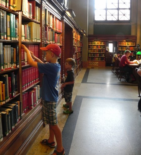 Looking at books in the Boston Public Library