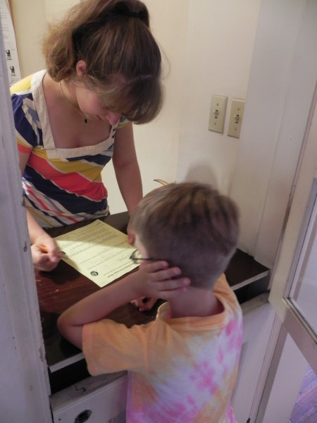 Checking scavenger hunt answers at Old South Meeting House