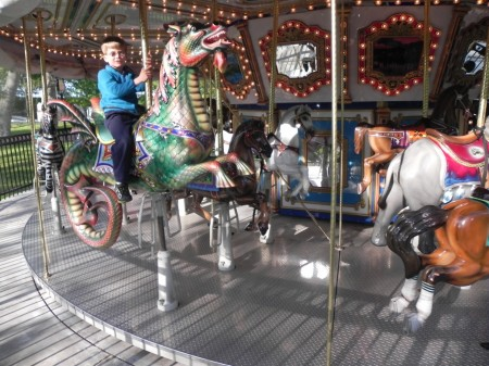Riding the carousel in Franklin Square, Philadelphia