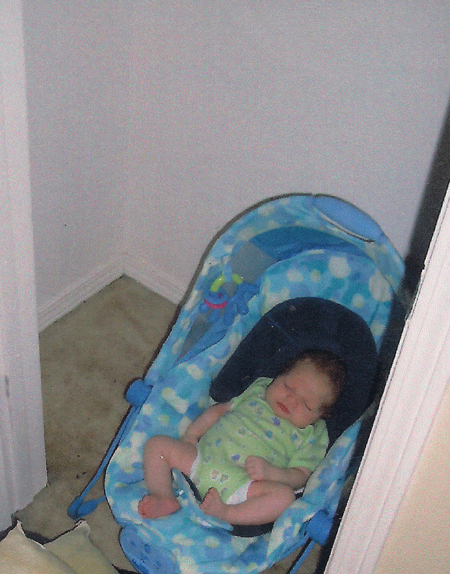 Baby sleeping in a closet during Hurricane Ivan