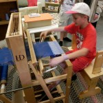 Tommy loved using a loom to weave in Historic Deerfield