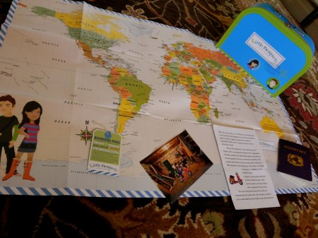 Little Passports welcome goodies include a world map and a passport