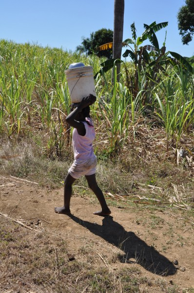 A child carries water in Haiti - courtesy Water.org