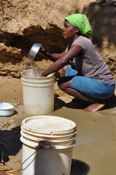 Seeking water from sand in Haiti - courtesy Water.org