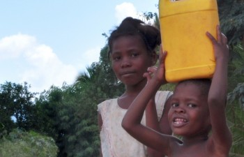Kids in Haiti carrying water - courtesy Water.org
