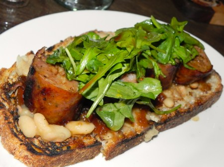 House-made sausage is served on a bed of beans and toast at the Red Owl Tavern in Philadelphia