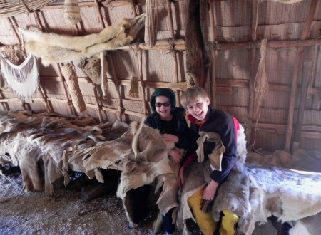 Warm and cozy wrapped in furs in the Powhatan village at the Jamestown Settlement Museum
