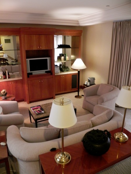 The sunken living room in the Townhouse Suite has a bay window and pullout couch