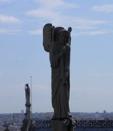 Angels and bishops atop Notre Dame in Paris