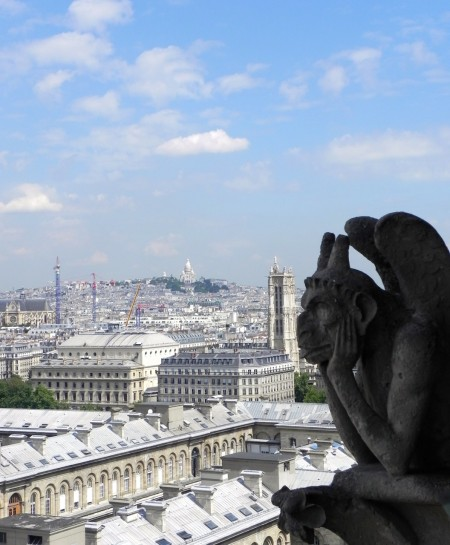A view of Montmartre framed by a gargoyle