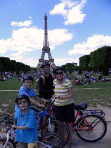 In front of the Eiffel Tower - the ultimate Paris with kids photo-op.