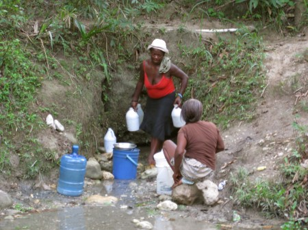 Gathering water and washing in Niva, Haiti