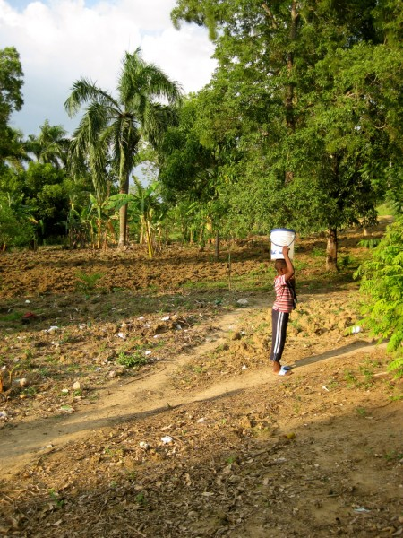 Carrying water in Niva, Haiti