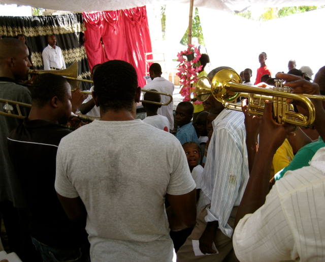 A rag-tag band played the Haitian national anthem
