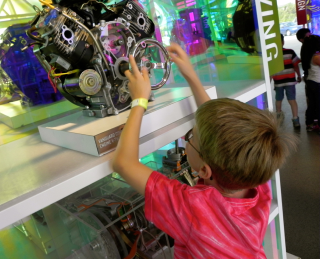 Exploring engines in the Milwaukee Muscle exhibit at Discovery World in Milwaukee