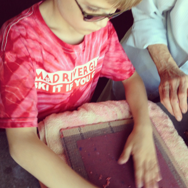 Making paper - he looks so serious! #milwaukee #wisconsin #familytravel
